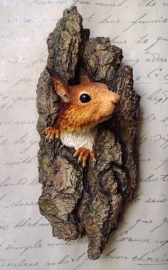 'Hope' - Red Squirrel wall mounted sculpture by Kirsty Armstrong in hand painted resin. Life size. www.justkirsty.com