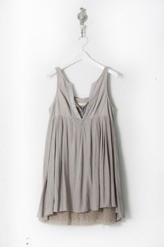 grey sleeveless blouse