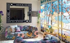 Beautiful stained glass wall to match bold floral sofas