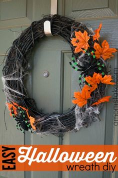 Super easy Halloween wreath DIY! Takes less than 15 minutes and $15 to put this cute seasonal wreath together.