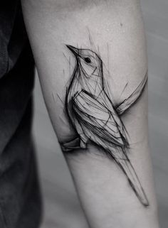 Kamil Mokot bird tattoo