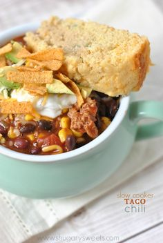 Slow Cooker Taco Chili Recipe _ So flavorful! Serve it up with a big side of Jalapeno Cheddar Cornbread & all the fixings - Greek yogurt or sour cream, shredded cheese, chopped avocado, & Southwestern tortilla strips.