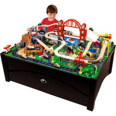 Our Kidkraft Metropolis Train Table and Set is compatible with Thomas & Friends and Brio wooden train sets. The Kidkraft Metropolis Train Table and Set features an espresso finish, trundle, 100 pc train set, airport with helipad, mountain and more! Train Set Table, Car Table, Lift Table, Pool Table, Kids Play Table, Wooden Train, Thomas The Train, Classic Toys, Model Trains
