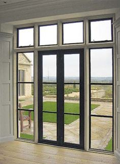 Standard bronze doors are framed with fixed and opening casements, all with horizontal transoms.