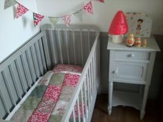 Patchwork quilt and flag bunting. Nursery. Crib.