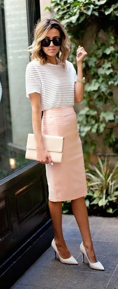 White shirt, pink pencil skirt, white heels, and white heels.