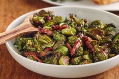 If there's one thing that makes a pan of roasted Brussels sprouts even better, it's bacon. Brussels sprouts pair well with its smoky flavor, and the fat rendered during roasting helps the leaves grow lacy and crisp. This dish, made to feed a full Thanksgiving table, adds one more element to the mix: a sweet, slight tart, apple cider glaze that's drizzled over the still-warm sprouts.