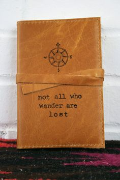 """Not All Who Wander Are Lost"" - A JRR Tolkein quote on a handcrafted leather journal. Awesome! What a great gift for travelers."