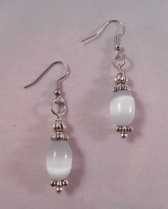 Under 4 inches, lightweight crafted with a medium-sized white glass bead. White earrings?  Yes!