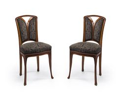 A pair of Majorelle carved mahogany sidechairs  circa 1900