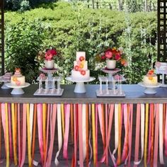 table skirt made of ribbons in place of a table cloth to add a pop of color. & can use the same idea for your party and even cut down on the cost by using colorful crepe paper streamers to create the same effect. Table Bar, Deco Table, Decoration Cirque, Wedding Decoration, Cake Table Birthday, Crepe Paper Streamers, Bar A Bonbon, Paper Table, Diy Ribbon