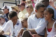 n this July 4, 2008 file photo, Democratic presidential candidate, Sen. Barack Obamaand his wife Michellewatch an Independence Day parade with their two daughters, Malia, right, and Sasha in Butte, Mont. (AP Photo/Jae C. Hong/FILE)  via @AOL_Lifestyle Read more: http://www.aol.com/article/news/2017/01/14/president-barack-obama-in-nbc-special-talks-legacy-how-he-work/21654998/?a_dgi=aolshare_pinterest#fullscreen