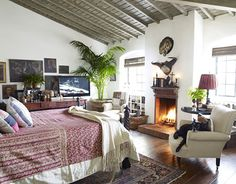 This bedroom in a Los Angeles apartment is by designer Dan Marty, and I love the ceiling and the fireplace!