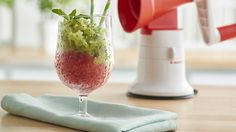 Whether you're making grown-up mojitos or shaved ice for the kiddos poolside, the Ice Shaver Cone for your Grate Master® is a summer must-have. This Strawberry Kiwi delight is a refresher for any age group—just top with rum if the audience calls for it!