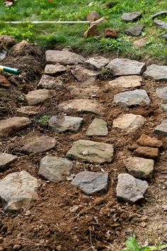 building rock pathways in the garden with rocks already in yard