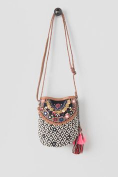 The cute Alena Mini Bucket Bag is all you need for your next music festival!