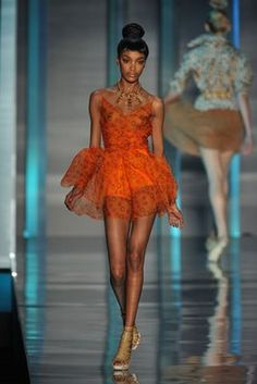 """London born Jourdan Dunn wearing a Gillano design for Dior. She was discovered at age 16 by legendary agency Storm Models (they also discovered Kate Moss). She's been unstoppable ever since. Voted as 2008 British Fashion Council's """"Model of the Year,"""" & one of the 4 cover models for Vogue Italia's iconic Black Models issue. Has graced the runways for nearly every top designer and making history as the first black model since Naomi to strut for Prada. Dec 2009 she became a mother to son…"""