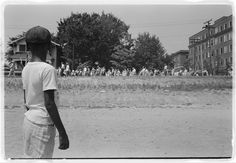 "Photograph shows a young African American boy watching a white group of people, some carrying American flags, march past to protest the admission of the ""Little Rock Nine"" to Central High School, Little Rock Crisis, Little Rock Nine, Cc Cycle 3, First Day Of School, High School, Civil Rights Movement, National Guard, Library Of Congress, African American History"