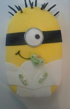 Minion Baby baby shower cake. Surprisingly enough, it's not as hard to make as one would think.