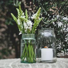 Allison & Tyson's Modern Indoor Wedding – Table Decor - assortment of jars and bottles