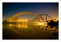 In the photo silver metallic structure is the Ayub Arch and the brown metallic structure is the historic Lansdowne bridge.