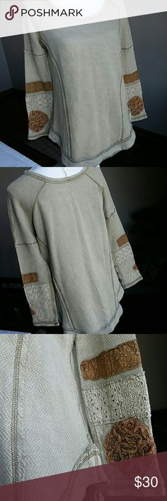 Like New Free People Long Sleeve Baseball jersey cut wth raw hem after sewn hem. So cute and comfy. Sleeves have lace and patches of fabric and embroidery. Interesting texture and contrasting stitch. Adorable! Slightly oversized. Tagged  XS but could fit up to Med in my opinion. Breastline 19.5, shoulder to bottom 28. Sleeve inseam 16.5 and shoulder to end of sleeve 25. Mint condition could pass as new, barely worn.100% cotton, machine washable. Free People Tops Tees - Long Sleeve