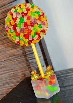 One topiary-like arrangement featured gummy bears. Overall there were 16 arrangements made out of candy on the bars and coffee tables.