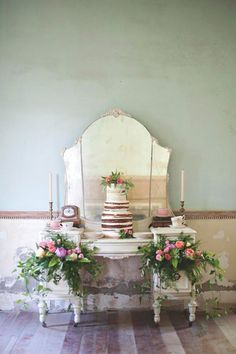 A vintage dresser provides the perfect cake table display for a vintage inspired wedding. // www.onefabday.com