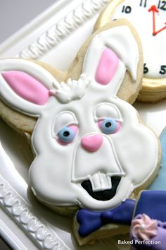 Alice in Wonderland Inspired Hand Decorated Cookies for Birthday, Wedding and Shower Favors with Chester Cat, Alice, and White Rabbit. $48.00, via Etsy.