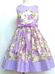 Girls or toddlers lilac and cream floral Easter dress, sizes 2T - 6.    As Mary Poppins would say, Its practically perfect in every way…..