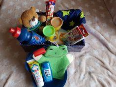 2017 - Junge 2-4 Jahre   Inhalt: Zahnbürste, Zahnpasta, Duschgel, Waschlappen, Pflaster, Brotdose, Flasche, Mütze, Teddybär, Memory, Knete, Schokolade