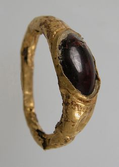 Finger Ring  Date: 7th century Geography: Made in, Northern France Culture: Frankish Medium: Gold, garnet cabochon