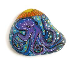 Painted Stone, Octopus Pebble Painting, Original Hand Painted Rock Art, hand painted and designed by Larryware.  Welcome to the colourful and original world of Larryware! My unique creations are modern, funky and quirky. Plus they can brighten up your day by wearing and enjoying modern art!  This is my own original painting - the secretive octopus living in the sea floor, sometimes waving at camera crews for their latest wildlife films!  - The stone measures approx 8.5 x 6.5cm. - It is…