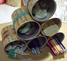 decorated paramid style desk organizer using tin cans
