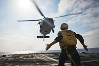 160705-N-OR652-084 MEDITERRANEAN SEA (July 5, 2016) Boatswain's Mate 3rd Class William Sweat, assigned to the guided-missile cruiser USS San Jacinto (CG 56), signals to an MH-60S Seahawk helicopter assigned to Dusty Dogs of Helicopter Sea Combat squadron (HSC) 7 as it takes off from the ship's flight deck. San Jacinto is deployed in support of Operation Inherent Resolve, maritime security operations and theater security operation efforts in the U.S. 6th Fleet area of operations. (U.S. Navy…