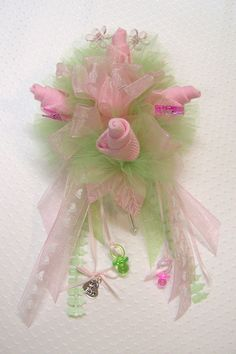 Mary's Baby Sock Corsage in Pink and Green by beesgiftshop on Etsy