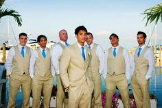 I like the idea of all the groomsmen in vests. I'd love this with teal ties! and a little different color tan