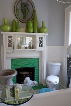 Gorgeous fireplace in a bathroom at decorator Barry Dixon's Virginia estate. This sits beside a clawfoot bathtub. I covet everything.