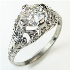 Walking on Air: This spectacular, ethereal ring is a masterpiece of Edwardian craftsmanship and design. A brilliant white diamond seems to levitate amidst shimmering veils and tendrils of diamond frosted platinum.  Ca1910. Maloys.com