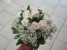 How to make a wedding bouquet with white roses, baby's breath and greens hand-tie style  by Patricia Chu  For http://www.patriciastudio.com  Flower Corner