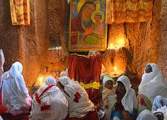 Women in prayers Ethiopia - Pinned by Mak Khalaf The small town of Lalibela in Ethiopia is home to one of the world's most astounding sacred sites: eleven rock-hewn churches each carved entirely out of a single block of granite with its roof at ground level.(Unesco world heritage) Travel africaatmospherebiblicalcandleschildchristianchristmaschurcheast africaethiopiahorn of africaiconesinsidelalibelalightlitte boymorningorthodoxpilgrimspriestreligionsacredsittingtoursimtravelunesco world…
