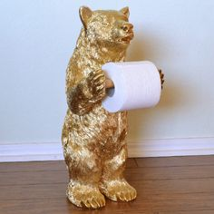 This golden bear toilet paper holder is as simple as wielding a can of spray paint! Make your own conversation piece or fun gift! Golden Bear, All That Glitters, Animal Paintings, T Shirts, Toilet Paper, Best Gifts, Diy Projects, Clay, Cool Stuff