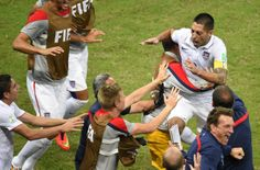 US forward Clint Dempsey (R) celebrates after scoring during a Group G football match between USA and Portugal at the Amazonia Arena in Manaus during the 2014 FIFA World Cup on June 22, 2014.