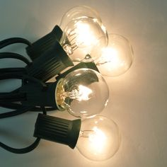 """G30 25 String Lights Set - Clear 1.25"""" 5 wt. 25 bulbs $25.95 12"""" spacing can run 2 sets total 60 bulbs, indoor/outdoor  If one light goes out the others stay on"""