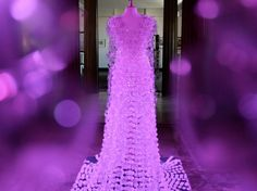 Rebecca Jasper. I Repinned this image. This dress is so beautiful and it is made from plastic bottles, caps and tags. This shows you don't always need to buy fabrics and spend money to be creative. It looks very expensive and designer , it's hard to believe it is made from recycled bottles.