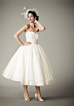 If not as a ceremony dress, definately an idea for the reception. I would love to have a kind of 40's-themed wedding!