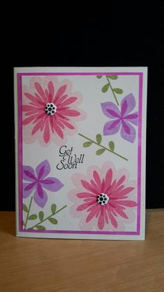 Stampin up - Flower Patch.  I used a regular ink pad from one of the colors on the flowers and a dauber and colored the edges.