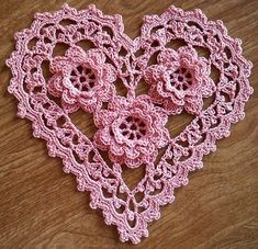"Irish Crochet Roses Heart by LaceCrochet on Flickr "" Slight variation of ""Rose Heart Sachet"" from Woman's Day Granny Squares No 8. The bottom rose in the photo has nine petals around the edge, instead..."
