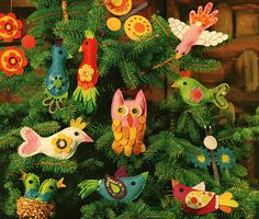 "OMG  I made these when I was 11.  Transferred the pattern using a 1"" grid and cut, sewed and glued them myself proudly showing my parents afterward.   of them hang on my tree every year - the owl, the babies in the ""nest"" and the bird with the heart tale.  This find has made my day."