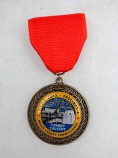 County Commissioner Tommy Calvert's 2015 Fiesta Medal Photo: Juanito M Garza, San Antonio Express-News / San Antonio Express-News